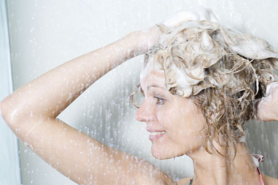 Woman shampoos head