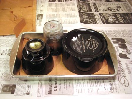 candle containers on a baking pan