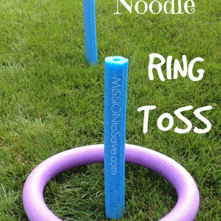 Pool noodle ring toss with blue noodle posts and purple noodle ring.