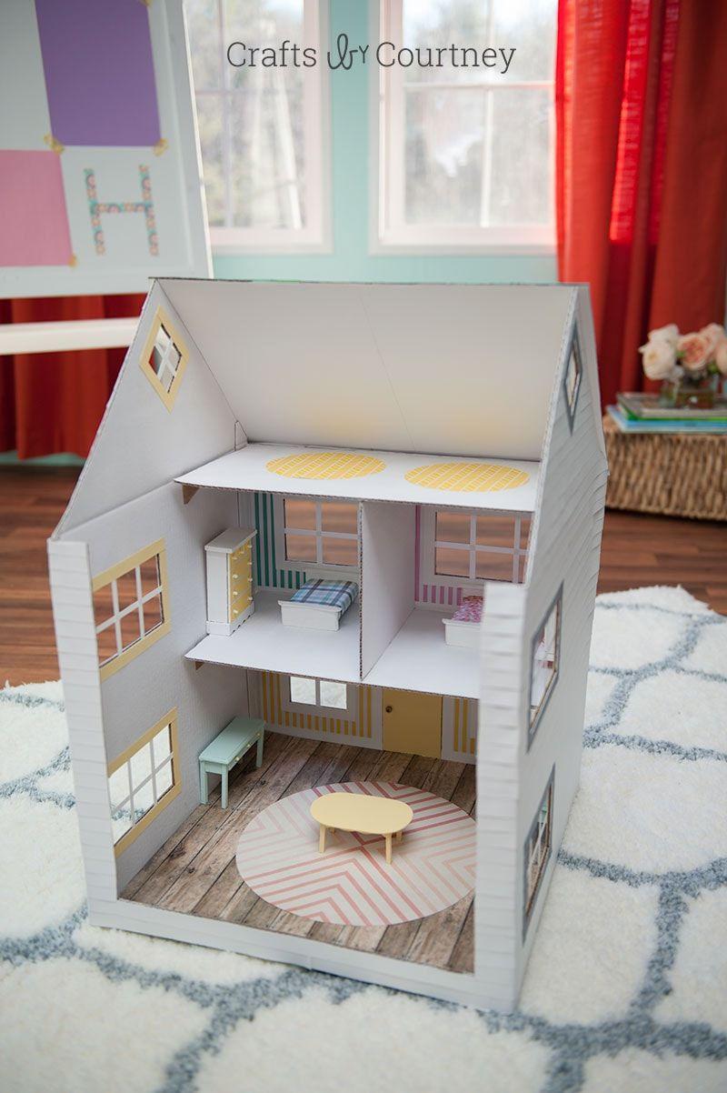 The back of a cardboard box dollhouse