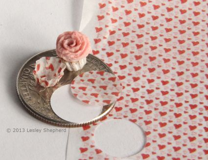 Tissue paper printed with tiny hearts used to make baking cups