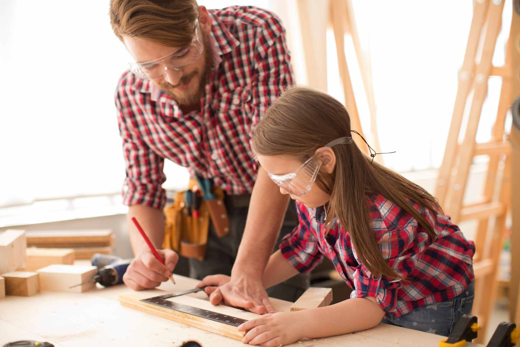 Father with his daughter in woodshop