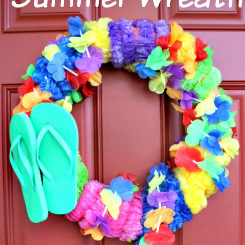 Pool noodle summer wreath hanging on red door with green flip-flops attached.