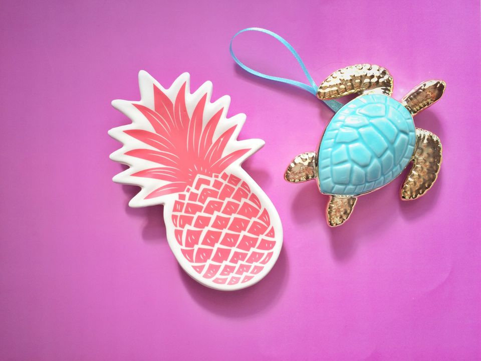 Pineapple coaster next to turtle ornament