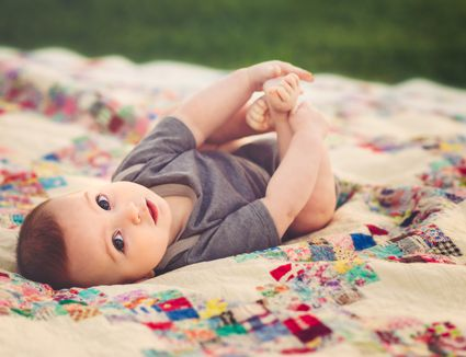Baby Boy On Vintage Quilt