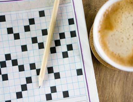 Pen on puzzle paper and coffee