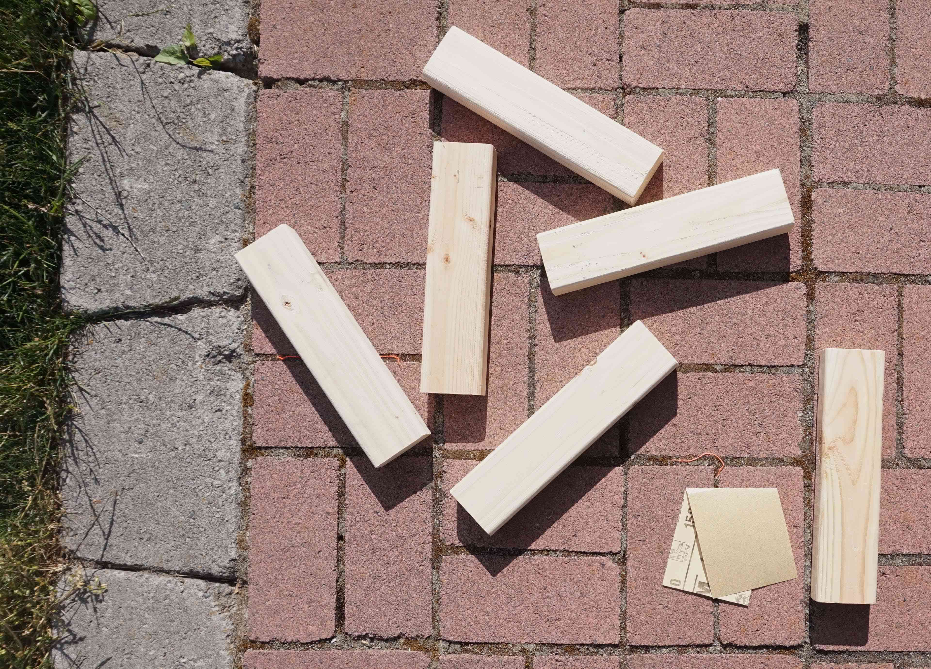 Wooden blocks on a patio next to sandpaper