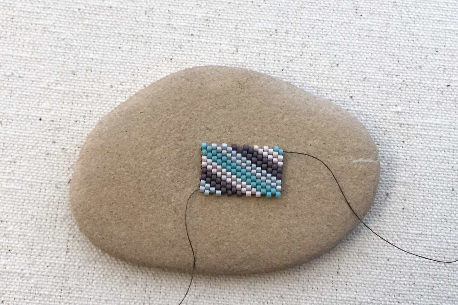 Peyote square before zipping it into a tube