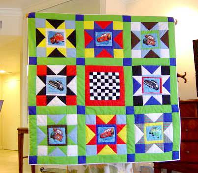 Baby quilt with characters from the movie Cars.