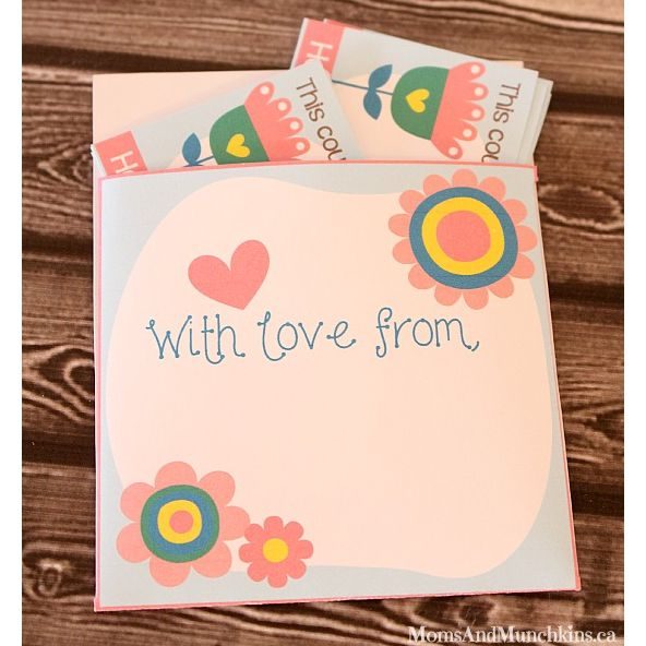 A packet of Mother's Day coupons laying on a table.