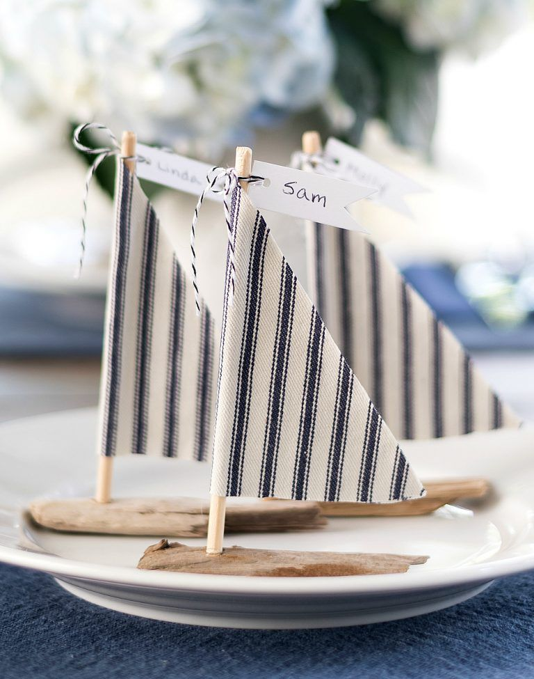 Driftwood sailboat displays for table settings.