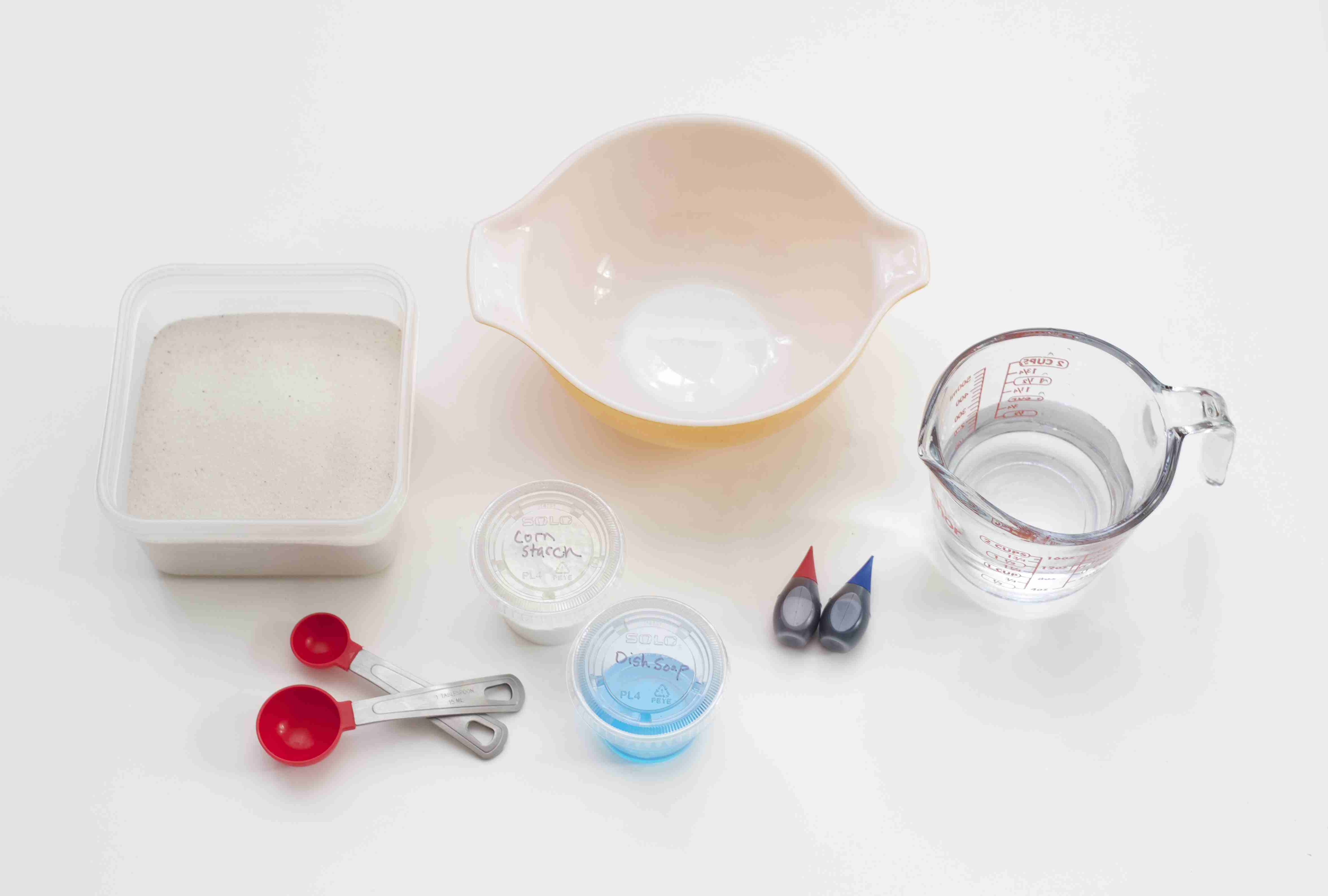 Measuring cups and ingredients gathered together