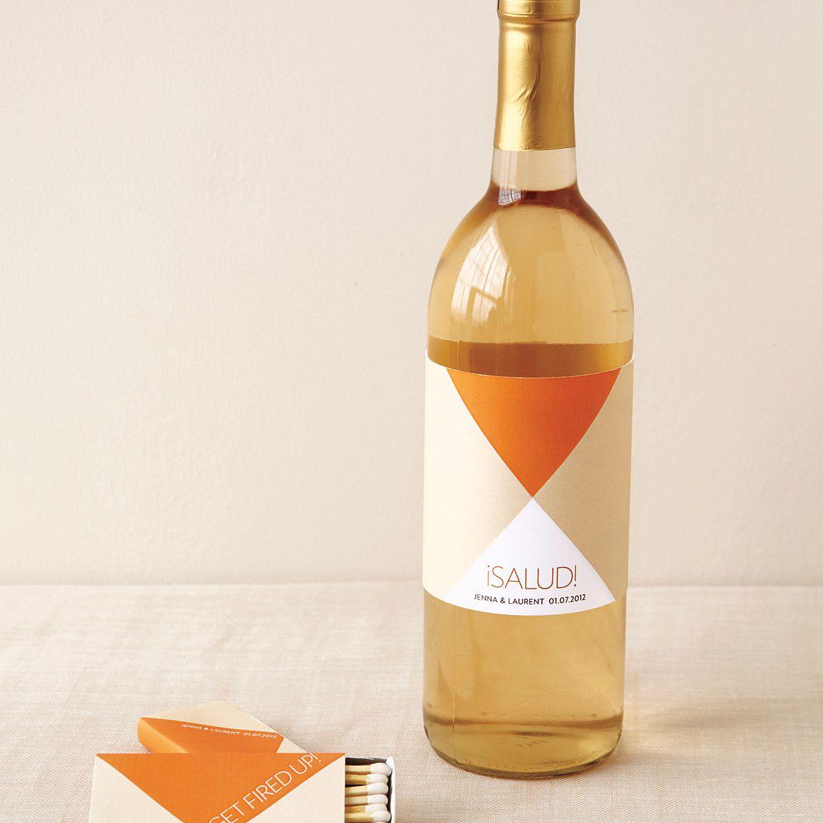 A orange and yellow bottle of wine