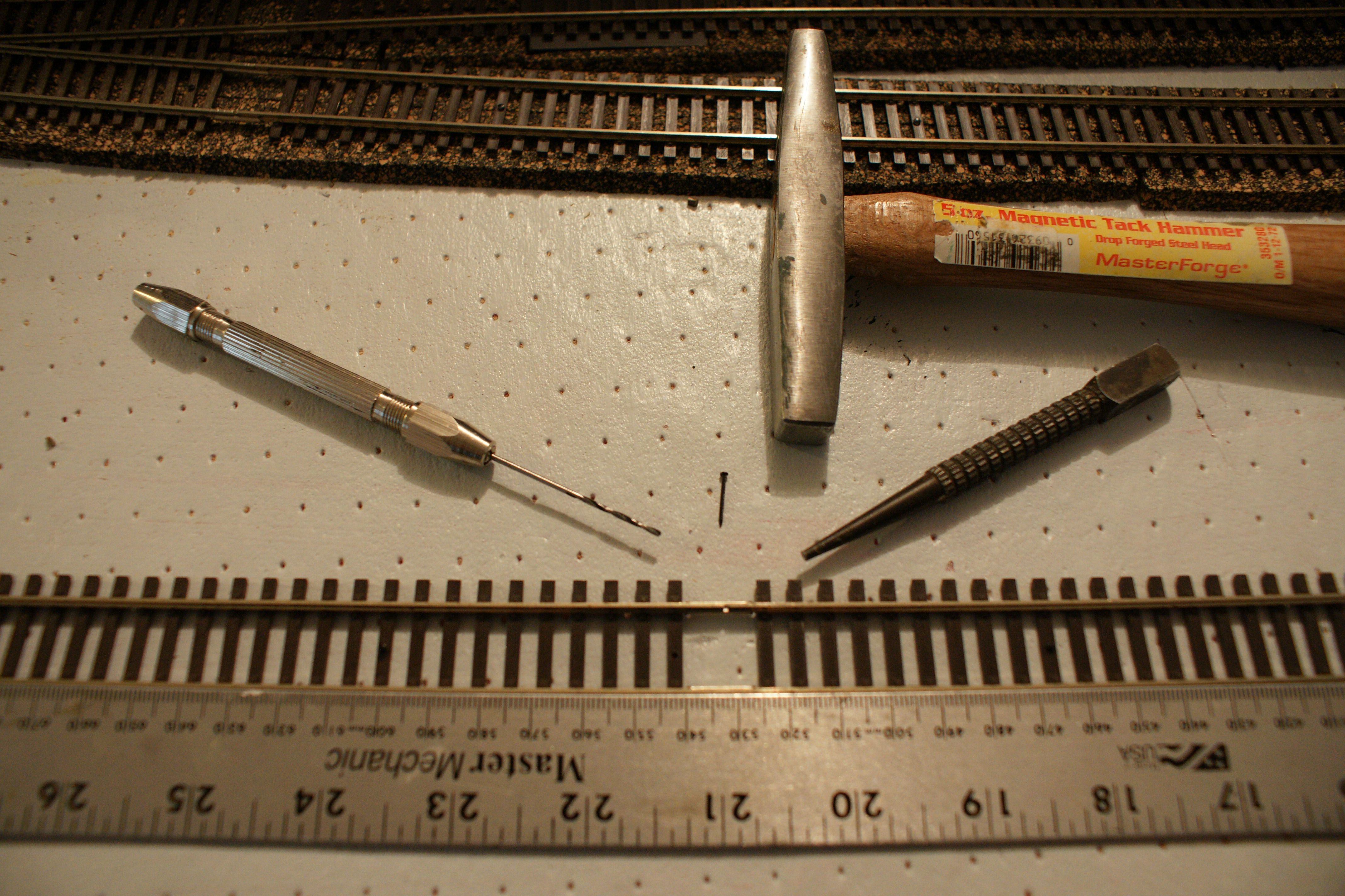 Model train flex track and steel straight edge