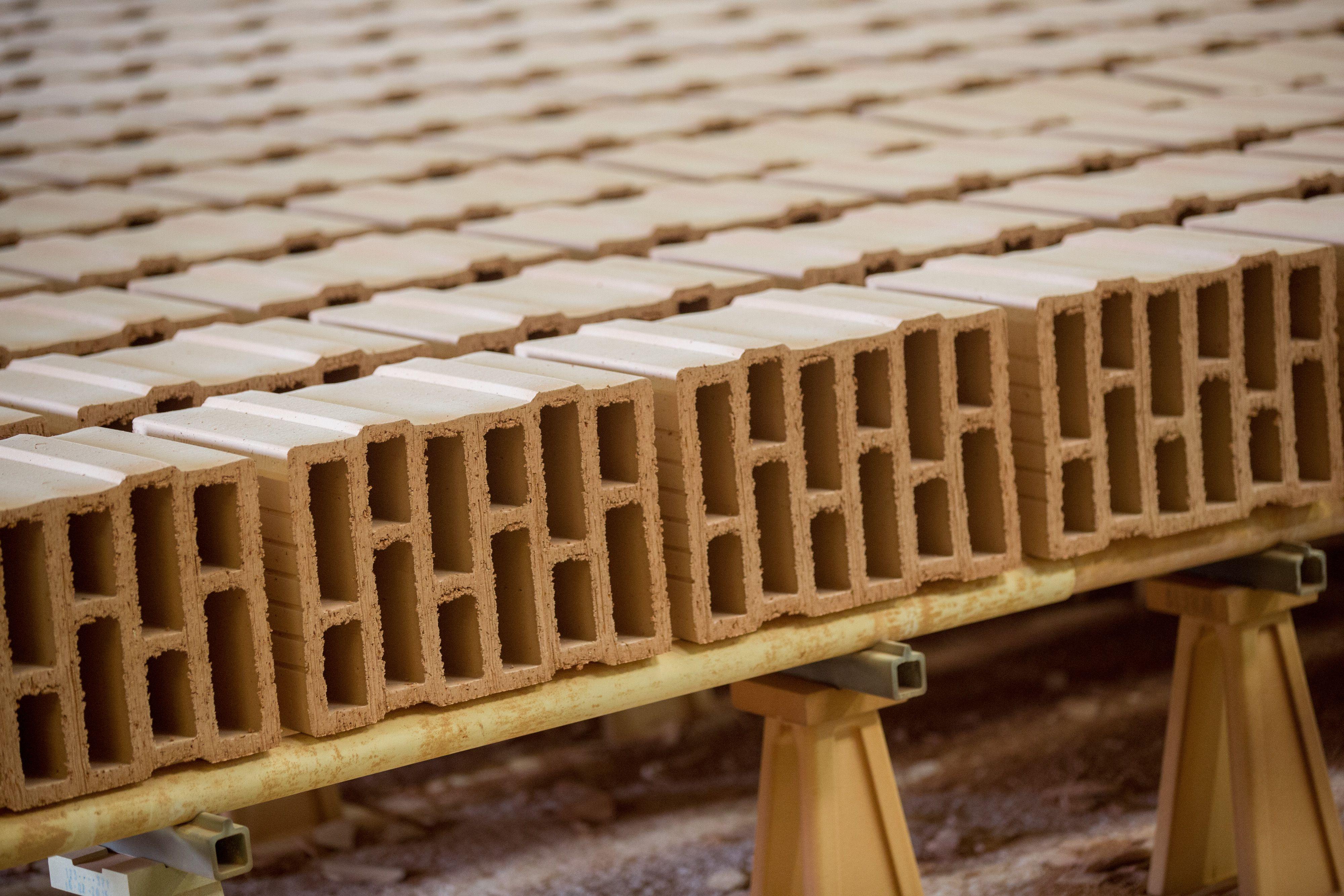 Fired clay bricks sit on a kiln car at a brickmaking plant