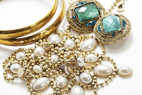 Collection of vintage jewelry on white surface
