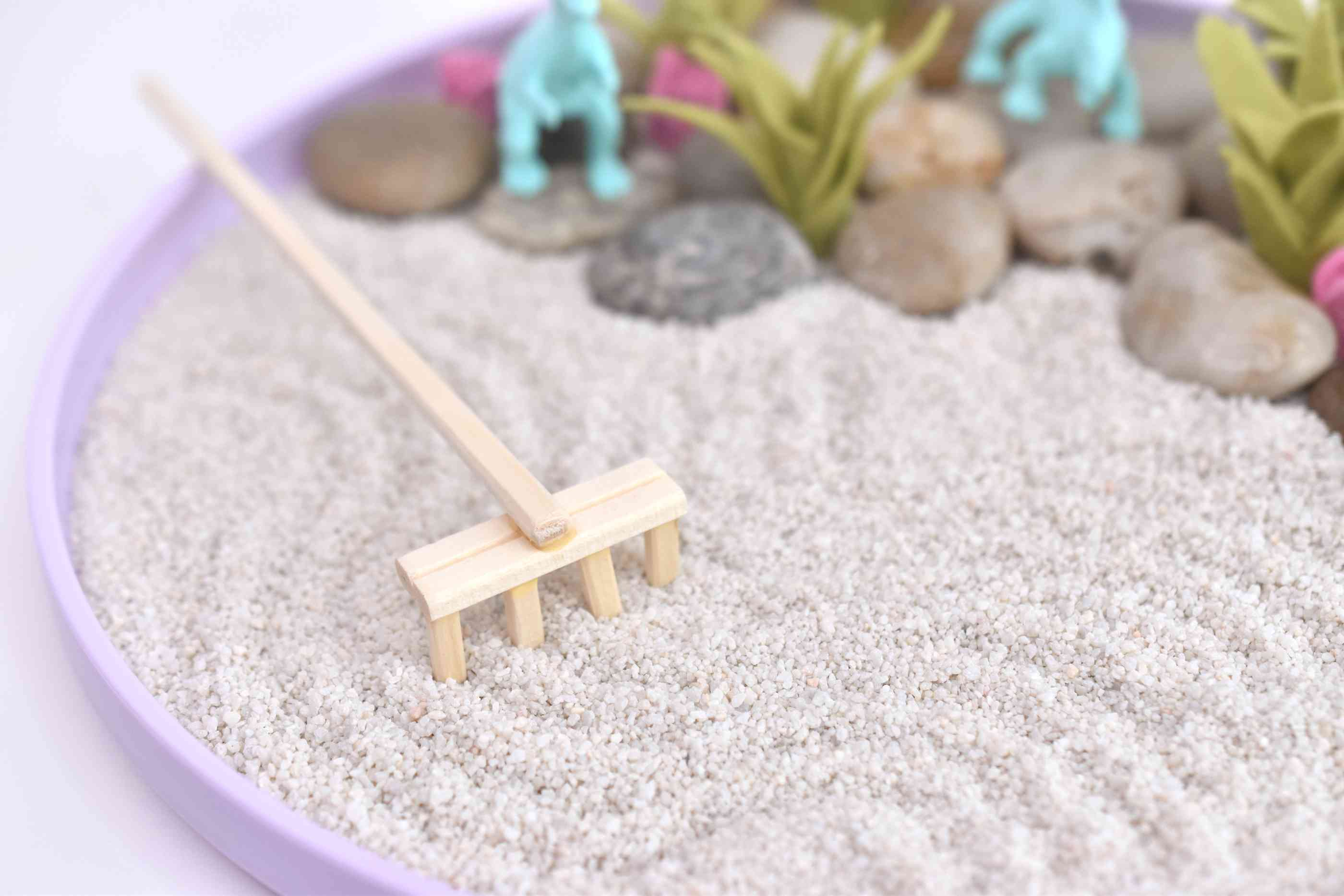 Use the Rake to Make Designs in the Sand