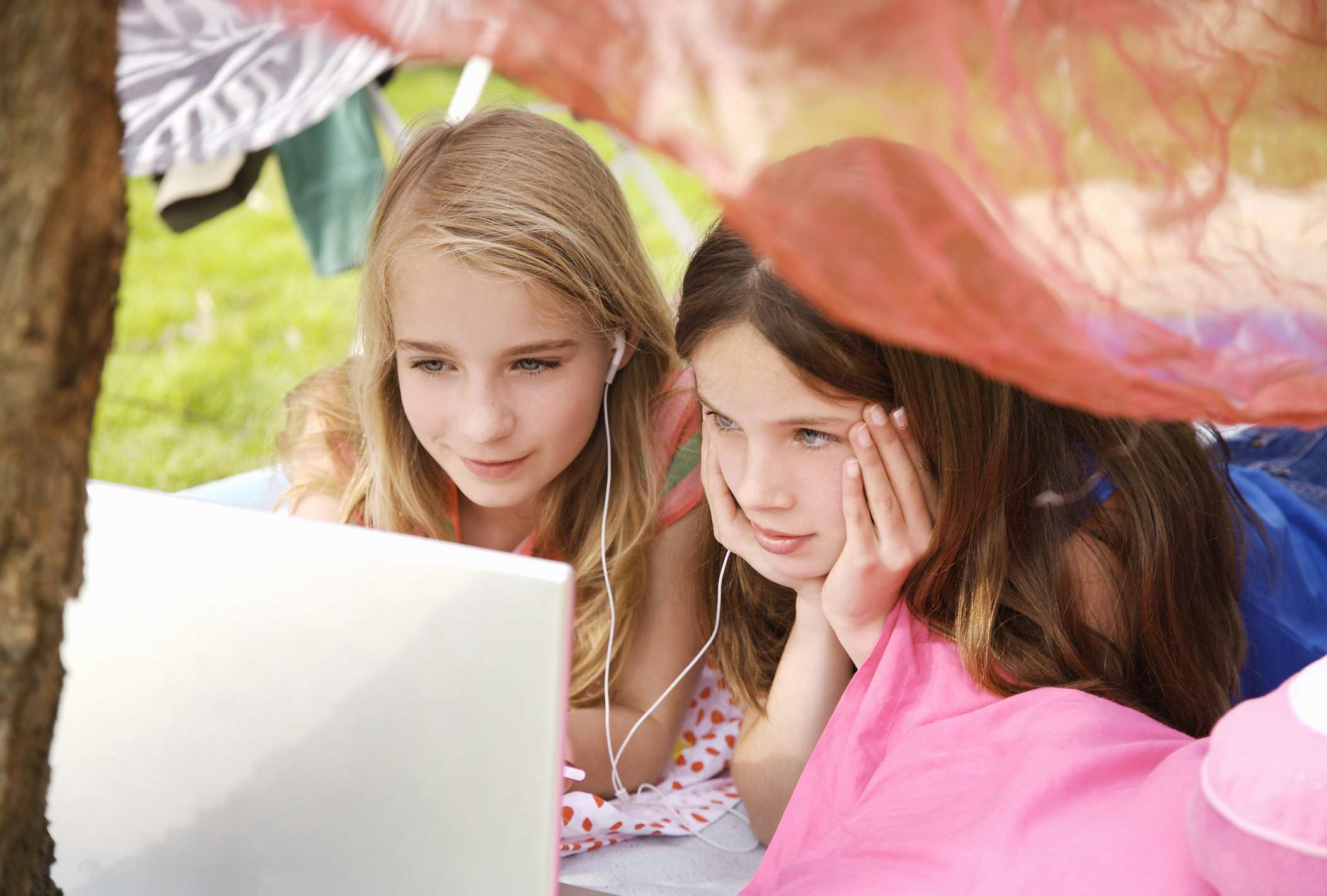 Girls Using Laptop and MP3 Player