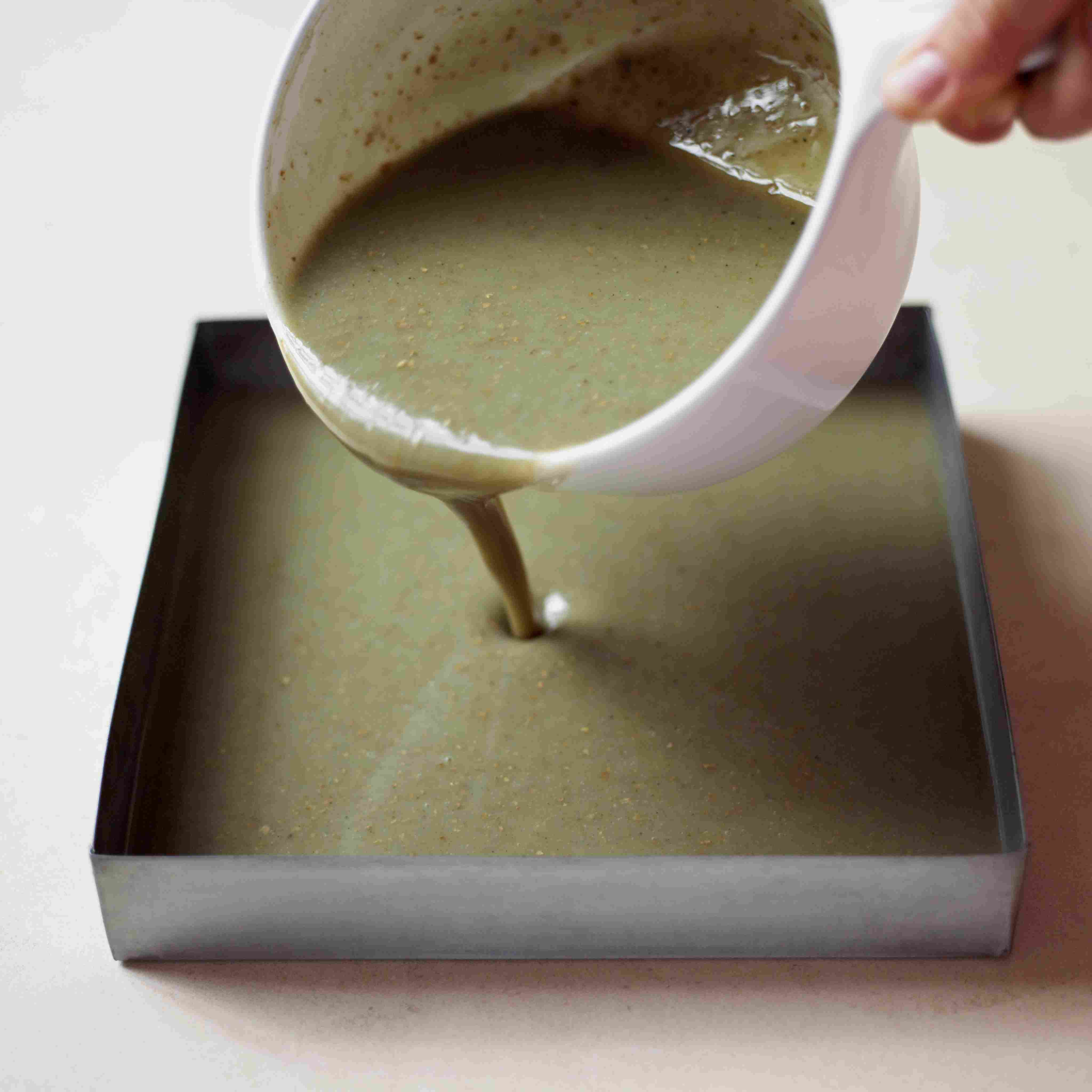Pouring melted soap mixture into square container