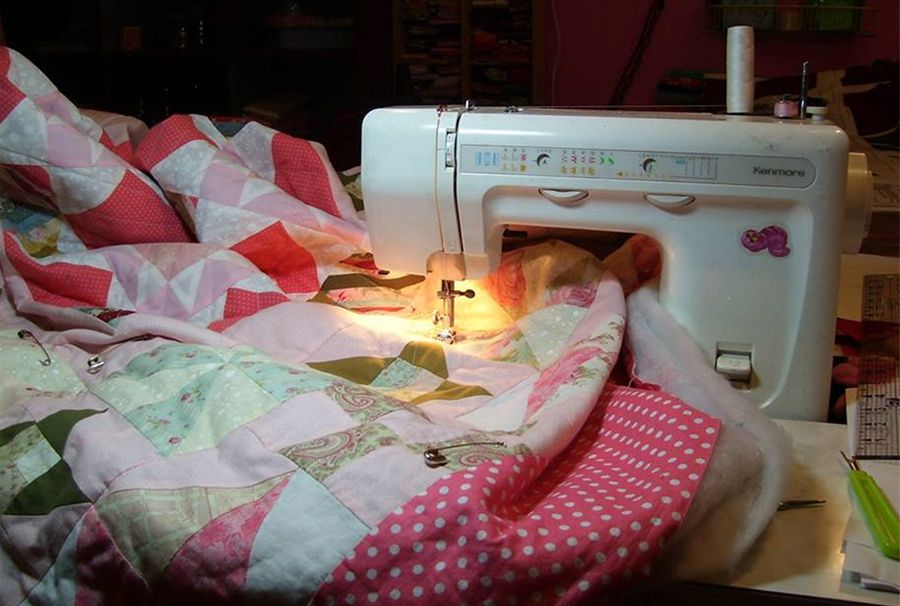 A Pin Basted Quilt Being Quilted